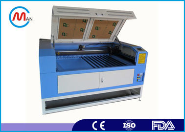 Cina Cnc 1390 Laser Cutting And Engraving Equipment For Plastic Pacifier pabrik